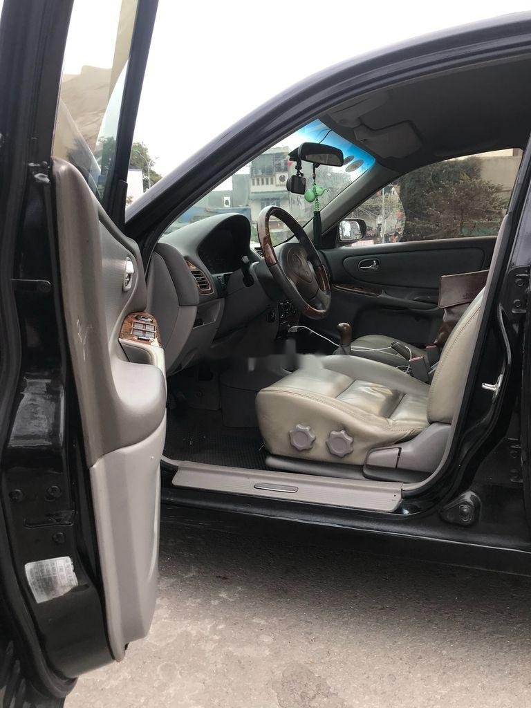Cần bán gấp Mazda 626 đời 2001, màu đen chính chủ (5)