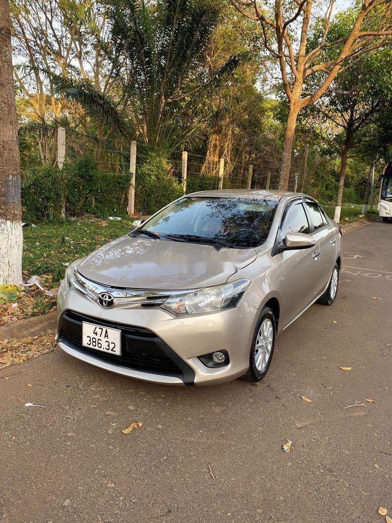Bán Toyota Vios sản xuất 2015, màu vàng cát, 310 triệu (1)