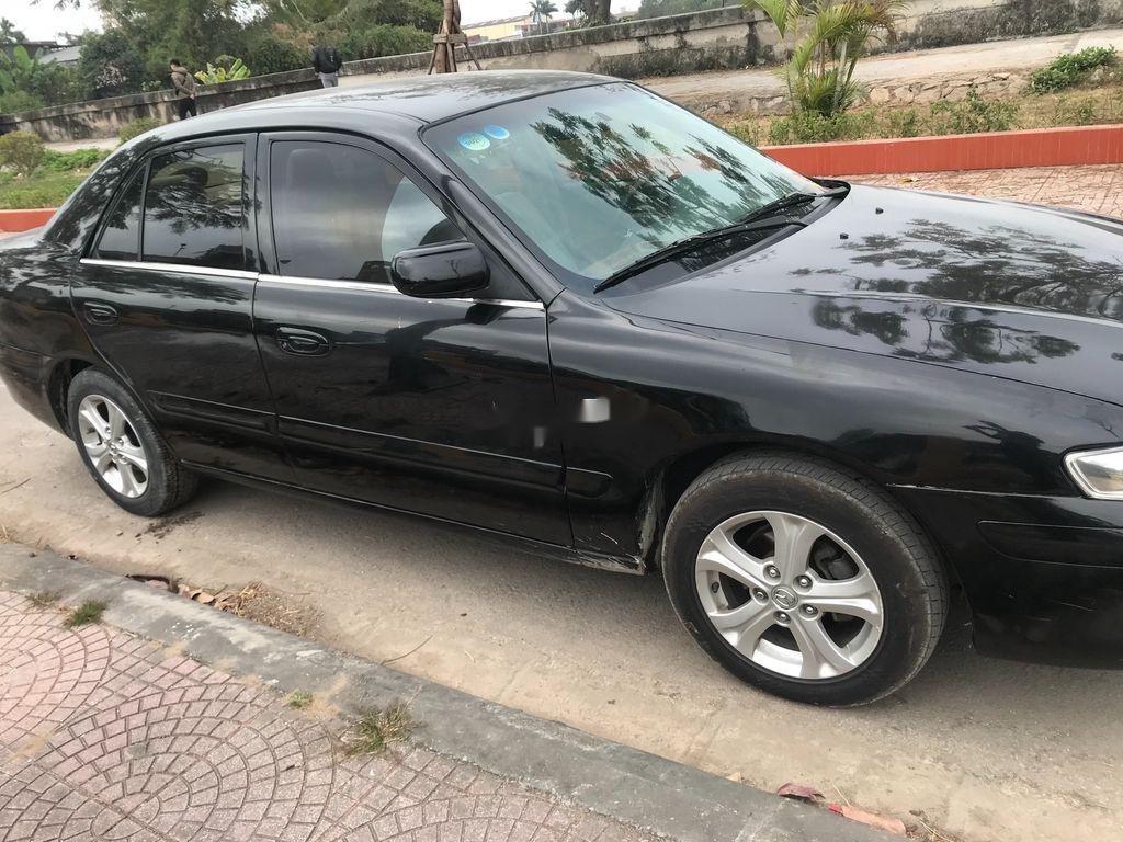 Cần bán gấp Mazda 626 đời 2001, màu đen chính chủ (3)
