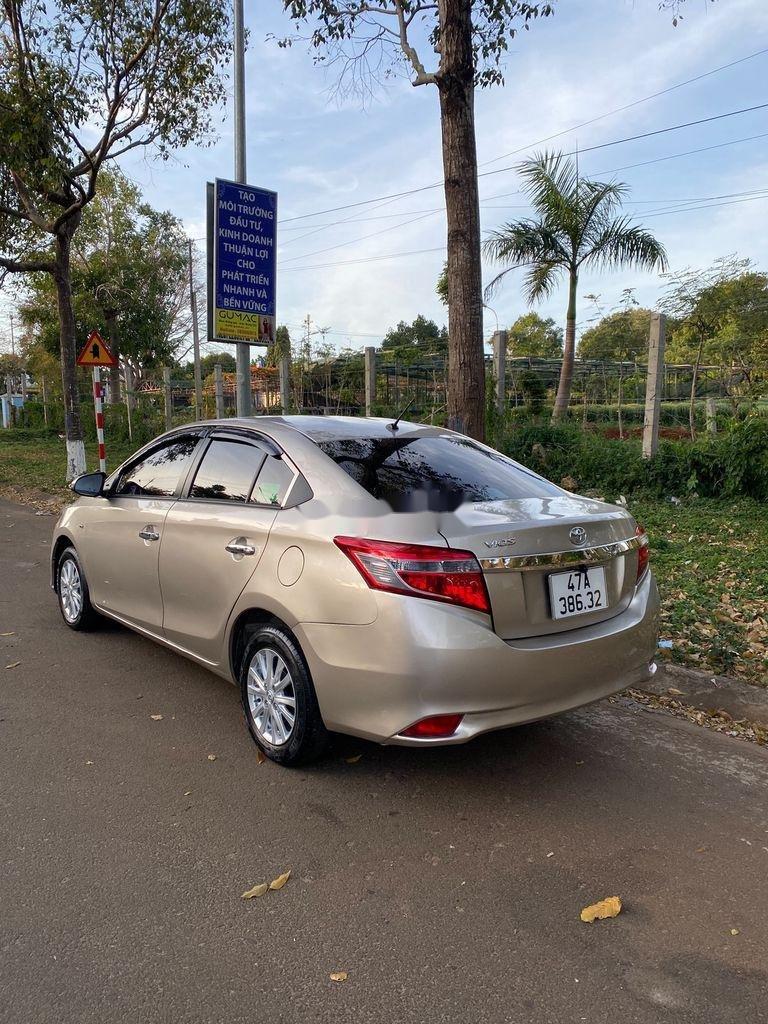 Bán Toyota Vios sản xuất 2015, màu vàng cát, 310 triệu (2)
