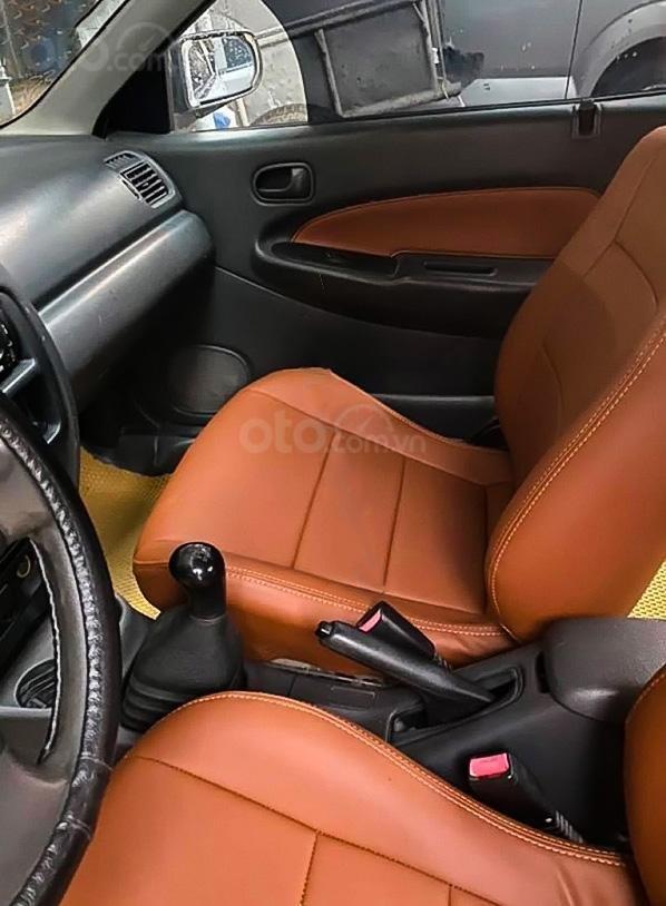 Cần bán gấp Mazda 323 sản xuất năm 2000, màu trắng (2)