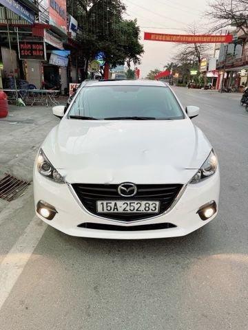 Cần bán xe Mazda 3 sản xuất 2016, màu trắng chính chủ, giá 526tr (1)