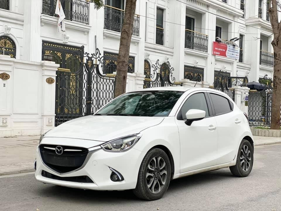 Bán gấp giá đẹp xe Mazda 2 1.5AT sản xuất 2016, màu trắng, biển Sài Gòn (1)