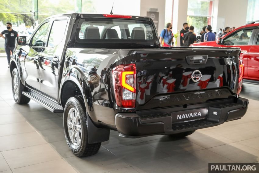 Nissan Navara 2021 đời mới thửa hưởng ngôn ngữ thiết kế từ Nissan Titan.