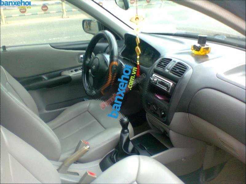 Xe Ford Laser  2003-2