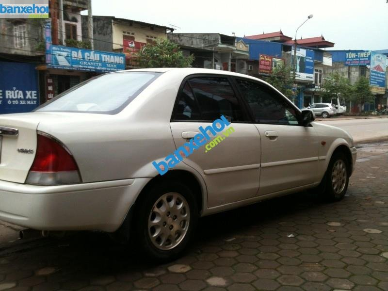 Xe Ford Laser  2001-3