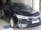 Cần bán lại xe Toyota Corolla Altis 1.8E AT năm 2017, màu đen