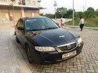 Bán Mazda 626 đời 2000, màu đen, xe nhập số sàn