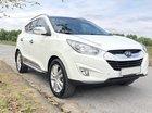 Cần tiền mua đất nên bán xe Hyundai Tucson 2.0 AT 4WD đời 2013, màu trắng, nhập khẩu nguyên chiếc chính chủ, 599tr