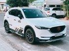 Cần bán CX5 màu trắng, đời 2018, đăng kí lần đầu tháng 12.2017, bản 2.5 một cầu
