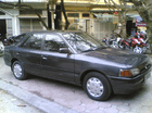 Cần bán gấp Mazda 323 sản xuất 1995 màu xám (ghi), giá tốt, xe nhập