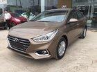 Hyundai Accent AT TC màu vàng cát, xe giao ngay, tặng bộ phụ kiện có giá trị, hỗ trợ vay lãi suất ưu đãi. LH: 0903175312