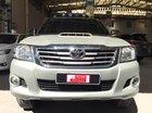Bán Toyota Hilux 2.4E đời 2014, màu bạc, xe bán tải máy dầu, số sàn, giá còn thương lượng