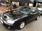 Bán xe Kia Spectra đời 2004, màu đen, số sàn, 135 triệu