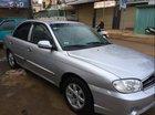 Bán xe Kia Spectra 1.6 MT 2004, màu bạc, xe gia đình
