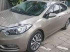 Cần bán Kia K3 2.0 AT sản xuất 2014, màu vàng