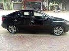 Gia đình cần bán xe Kia Forte đời 2010, số tay, máy xăng, màu đen