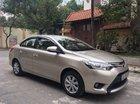 Cần bán Toyota Vios E đời 2014, màu ghi vàng, chính chủ Hà Nội