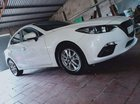 Cần bán gấp Mazda 3 đời 2015, màu trắng, giá tốt