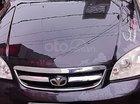 Bán xe Lacetti EX sản xuất năm 2009, số tay, máy xăng, màu đen, nội thất màu ghi, đã đi 169810 km