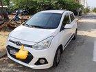 Cần bán xe Hyundai Grand i10 sản xuất 2014, màu trắng, xe nhập