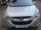 Cần bán Hyundai Tucson 2.0 AT 4WD đời 2010, màu bạc, nhập khẩu