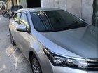 Bán xe Toyota Corolla altis 1.8G 2014, màu bạc số sàn, 560tr