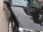 Bán BMW 3 Series 318i sản xuất 2004, màu đen, xe đẹp long lanh