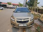 Cần bán xe Chevrolet Cruze MT đời 2014, màu vàng, nhập khẩu, đã đi 60.000km