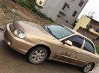 Cần bán lại xe Kia Spectra năm sản xuất 2004, màu vàng