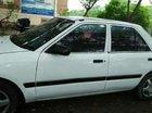 Cần bán xe Mazda 323 MT 1996, màu trắng, máy ngon, nội thất đẹp, trợ lực kính điện