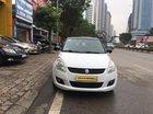 Cần bán xe Suzuki Swift 1.4AT sản xuất 2013, màu trắng, nhập khẩu