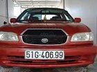 Bán xe Toyota Corolla màu đỏ, sản xuất 2001