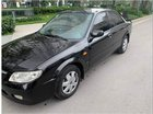 Cần bán xe Mazda 323 đời 2004, màu đen, xe gia đình