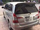 Bán lại xe Toyota Innova sản xuất năm 2014, màu bạc số tự động