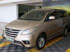 Cần bán Toyota Innova E 2.0MT 2014, màu vàng
