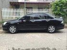 Cần bán Mitsubishi Lancer đời 2005, màu đen số tự động
