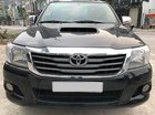 Cần bán xe Toyota Hilux bán tải máy dầu 2015 màu đen
