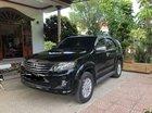Cần bán lại xe Toyota Fortuner MT sản xuất 2012, màu đen, bao đẹp, nội thất bọc da Ý