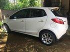 Cần bán xe Mazda 2 S 1.5 AT đời 2011, màu trắng, máy móc êm