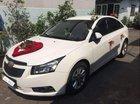 Cần bán xe Chevrolet Cruze MT sản xuất 2015, màu trắng, xe một chủ mua mới từ đầu