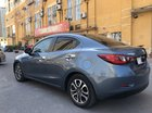 Cần bán Mazda 2 Sedan sản xuất 2016, màu xanh lục