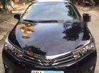 Bán Toyota Corolla Altis 1.8G AT 2014, màu đen xe gia đình