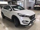 Bán Hyundai Tucson 2.0AT bản đặc biệt màu trắng, số tự động sản xuất 2018, biển Sài Gòn 1 chủ