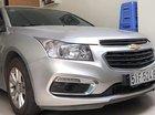 Bán Chevrolet Cruze LT 1.6MT 2015, màu bạc, xe gia đình