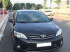 Cần bán xe Toyota Corolla altis 1.8G MT sản xuất 2011, màu đen, xe nguyên bản, đi rất giữ gìn