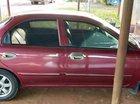 Gia đình bán xe Kia Spectra năm 2004, màu đỏ, xe nhập