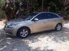 Cần bán Chevrolet Cruze 2010 màu vàng cát