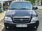 Cần bán xe Kia Carnival 2.5AT đời 2009, màu đen