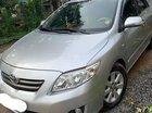 Gia đình bán Toyota Corolla Altis 1.8G năm 2010, màu bạc